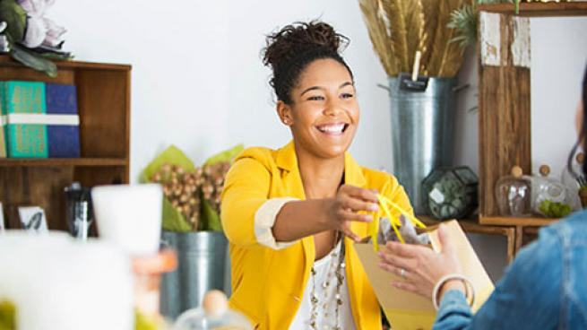 retailer employee helping customer