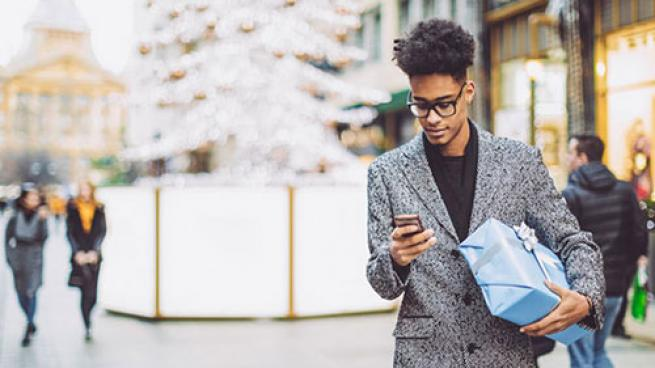 holiday shopper using mobile device