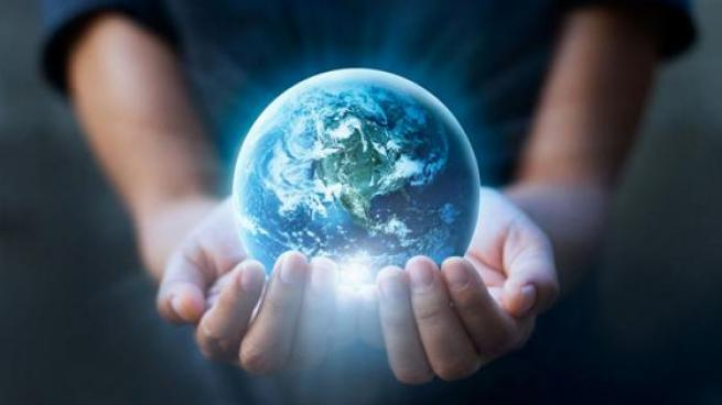 Person holding planet