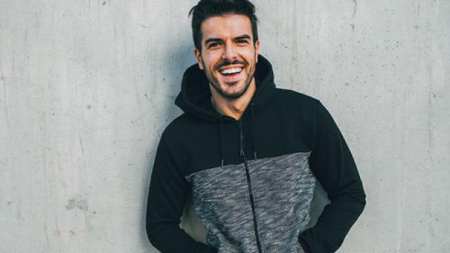 man posing with activewear