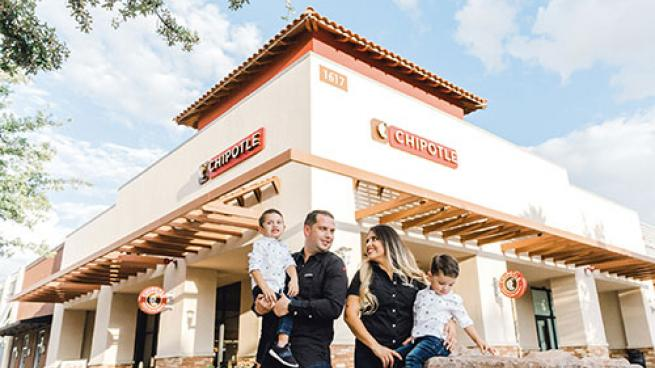 Chipotle employee with family
