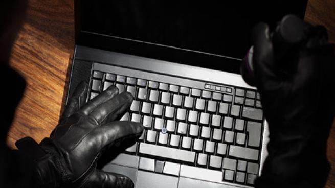 criminal on laptop