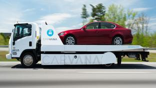 Truck hauling car