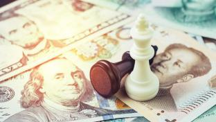 Chinese and American money with chess pieces
