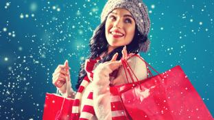 Woman in snow with shopping bags