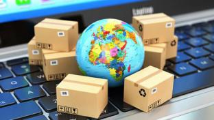 Globe on keyboard surrounded by packages