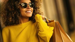 woman with sunglasses and shopping bags