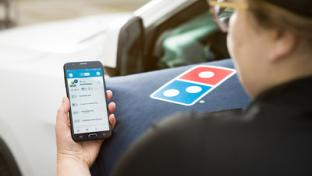 dominos delivery person holding mobile phone
