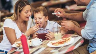 family eating at fast-casual restaurant