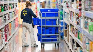 Walmart employee stocking shelf