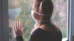 woman in isolation wearing mask