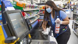 Walmart employee wiping POS