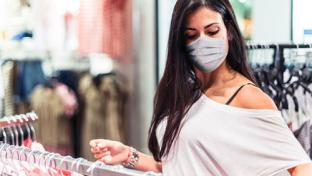 Woman shopping at retail store with mask on