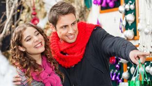 man and woman holiday shopping