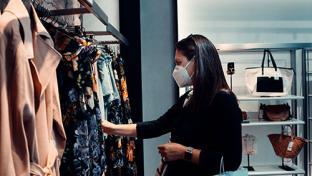 woman shopping in store wearing mask